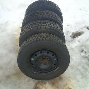 16 inch Motomaster all terrain snow tires.