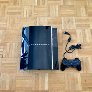 Playstation 3 (PS3) with 1 controller and 8 blockbuster games