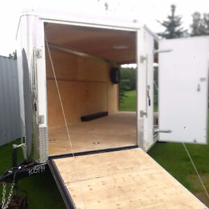 enclosed cargo hauler trailer-side by-cargo-moving-extra height-