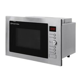 Combination built in microwave oven by Russell Hobbs excellent condition little used.