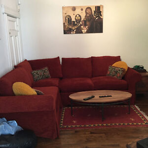 Beautiful dark red sectional couch. RECENTLY RE-COVERED
