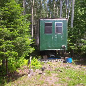 Converted Transport Trailer on 66x132' lot