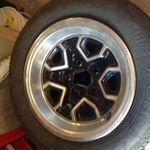 4 14 inch chev rally rims and tires