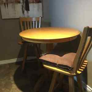 Solid wood pub style table and 2 swivel chairs Kingston Kingston Area image 1