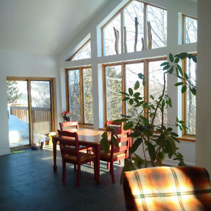 Spacious & bright architectural home overlooking Gatineau River