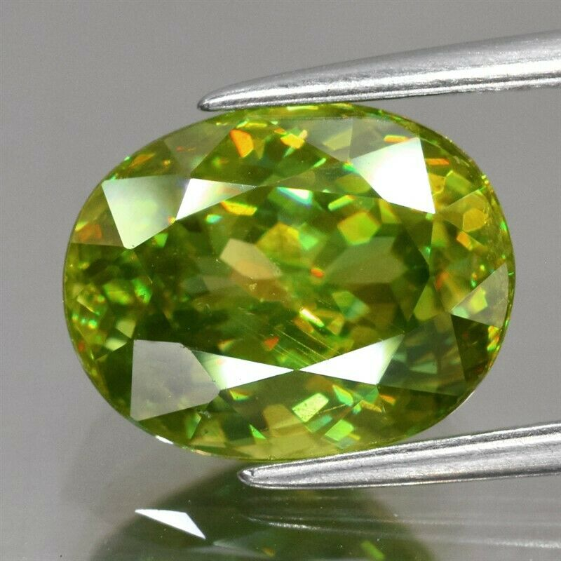 4.24ct 10.4x8.3mm Oval Natural Yellowish Green Sphene Madagascar, Amazing Luster