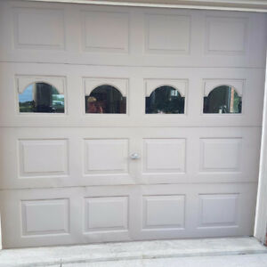 3- 9x8 insulated garage doors