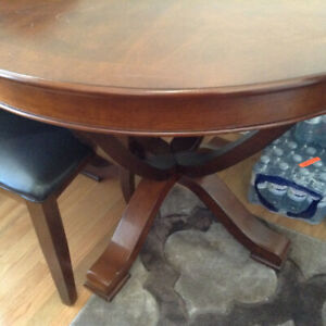 Round wooden dining room table and 4 chairs for sale