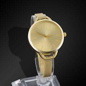 # 225 - Montre-bracelet pour dames de couleur OR .