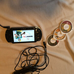 PSP with charger and 3 games