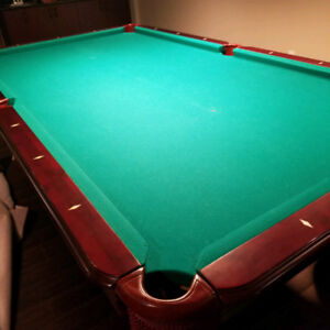 Pool Table (9 feet by 5 feet ) in excellent condition