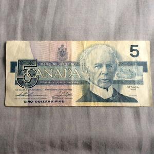 Paper money 5 dollar bill