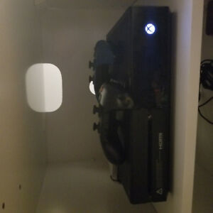 Looking to trade my xbox one with games and controllers for ps4