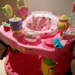 Gently used pink party baby bouncer