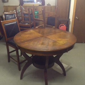 Nice solid wood table and six chairs