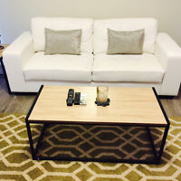 Couch, coffee table set, rugs, etc