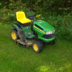John Deere ride on, includes trailer and snow blower attachment
