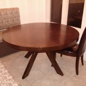 dark cherry round kitchen table with 4 leather chairs