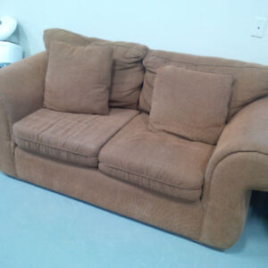 Brown 2-seater sofa in good condition