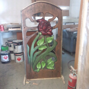 Hand carved fence gate panel