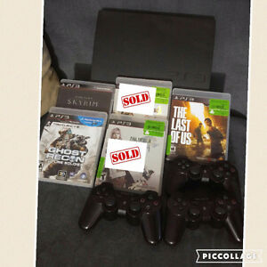 PS3 with 3 controllers and 3 games.