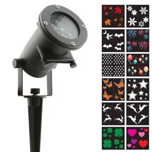 NIGHT STARS HOLIDAY CHARMS 12PC MOTION PROJECTION LIGHT - FJN