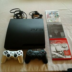 Playstation 3 with 2 controller and 3 games