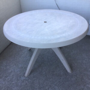 Vinyl  round patio table - 3  vinyl folding chairs and curtains