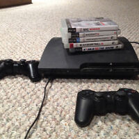 Playstation 3 with games, controllers & cords.