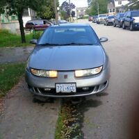 1999 Saturn S-Series--never rust, runs great, grandmas car