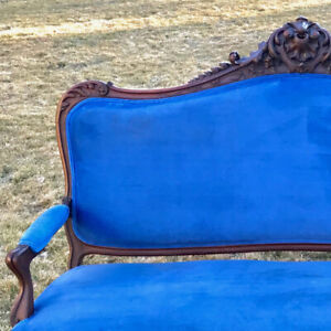 Striking blue velvet vintage sofa with pristine wood trim!
