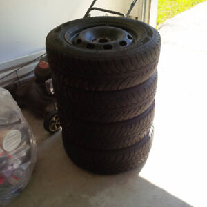 Goodyear 195/65R15 snow tires on rims