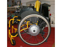 Wheelchair with Electric Wheels. Wheels can be put on mostly any manual wheelcair. Great Bargain :)