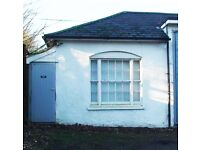 Workshop/studio/office/storage unit to let including parking. Quiet location in Surrey. M25 and A3