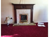 Mahogany fire surround with brass fender