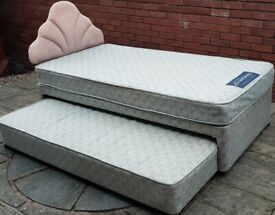 trundle bed + mattress + headboard. In used but good condition.