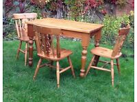 Pine dining table and three chairs