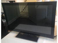 """24"""" LED TV with integrated DVD player good condition, comes with stand and remote control."""