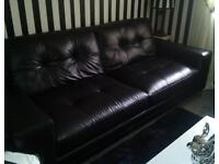 As new 3 and a 2 seater real leather black sofas