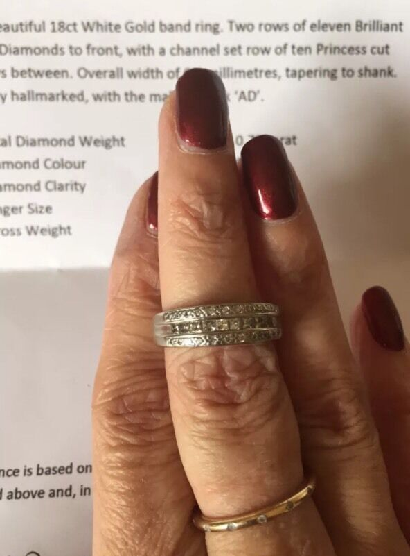 White gold diamond eternity wedding ring 0.75 caratin Ascot, BerkshireGumtree - PLEASE NOTE YELLOW GOLD RINGS IN PICTURE ARE NOT INCLUDEDPLEASE ALSO NOTE CURRENTLY A SIZE N NOT Q & WEIGHT 10 GRAMMES see belowBeautiful 18 carat white gold diamond band ring. Could be used as eternity or wedding ring also.Total of 22 brilliant cut...