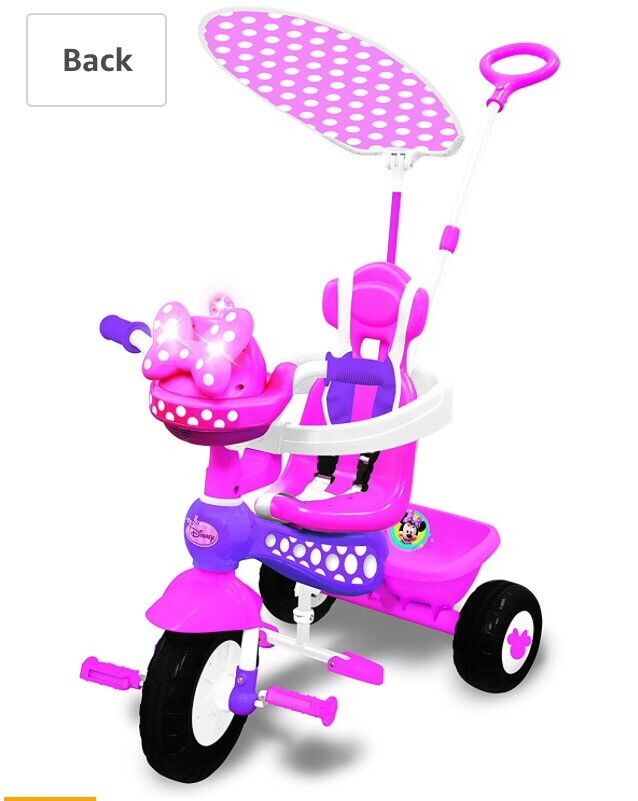 Pink trike Minnie Mouse lights and sounds