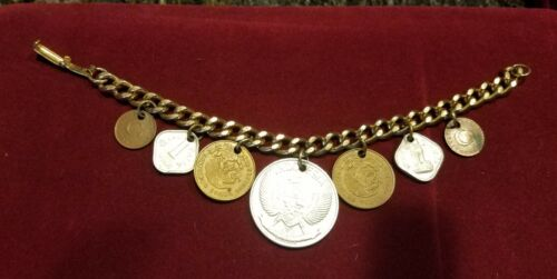 Vintage bracelet with 7 coins India, Mexico, Indonesia, Turkey~Goldtone~7.5 in.