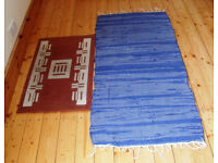 1 fringed blue rug @ £2.50 and 1 rust & cream mat @ £1.50. Or £3 ovno for both