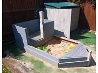 Wooden pirate ship sand pit