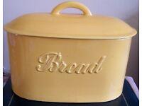 Yellow Ceramic bread bin and three storage jars. Perfect condition.