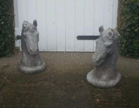 Horse heads gate or wall statues