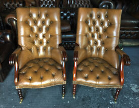 Pair of tan leather Chesterfield library chairs
