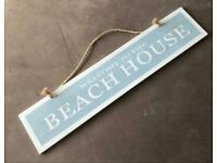 Welcome to the beach house sign
