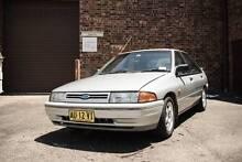 1990 Ford Laser Sedan 1.8L Silver Alloy Wheels, CD Player Camperdown Inner Sydney Preview