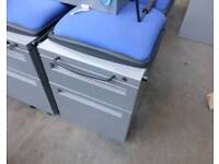 Grey metal 2 drawer mobile office pedestal with blue cloth padded seat